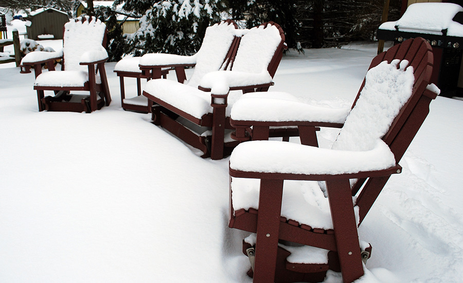 poly furniture covered with snow