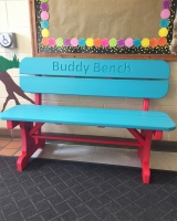 four foot poly bench with back shown in Aruba blue on red