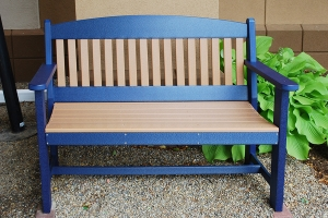 4ft garden bench shown in cedar on blue