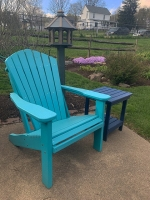 adirondack chair in Aruba blue, end table in blue, bird feeder in green on weathered wood.
