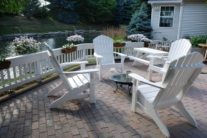Adirondack chairs and child's picnic table shown in white