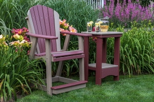 "adirondack stationary chair, counter height, shown in cherry on weatherwood w/ 31"" oval end tale shown in weatherwood on"